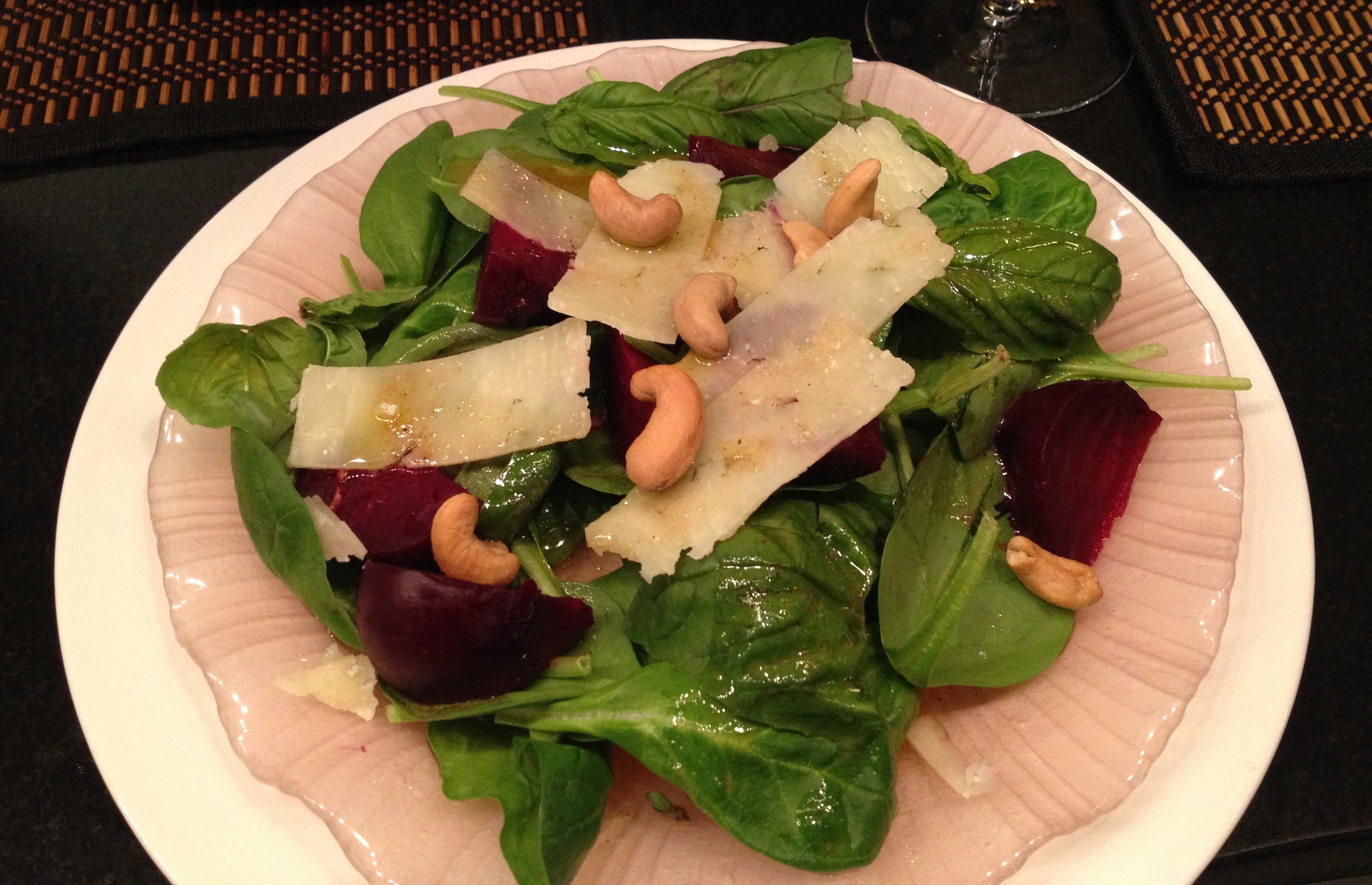 Beef stew spinach salad with basil, beets pecorino, cashews