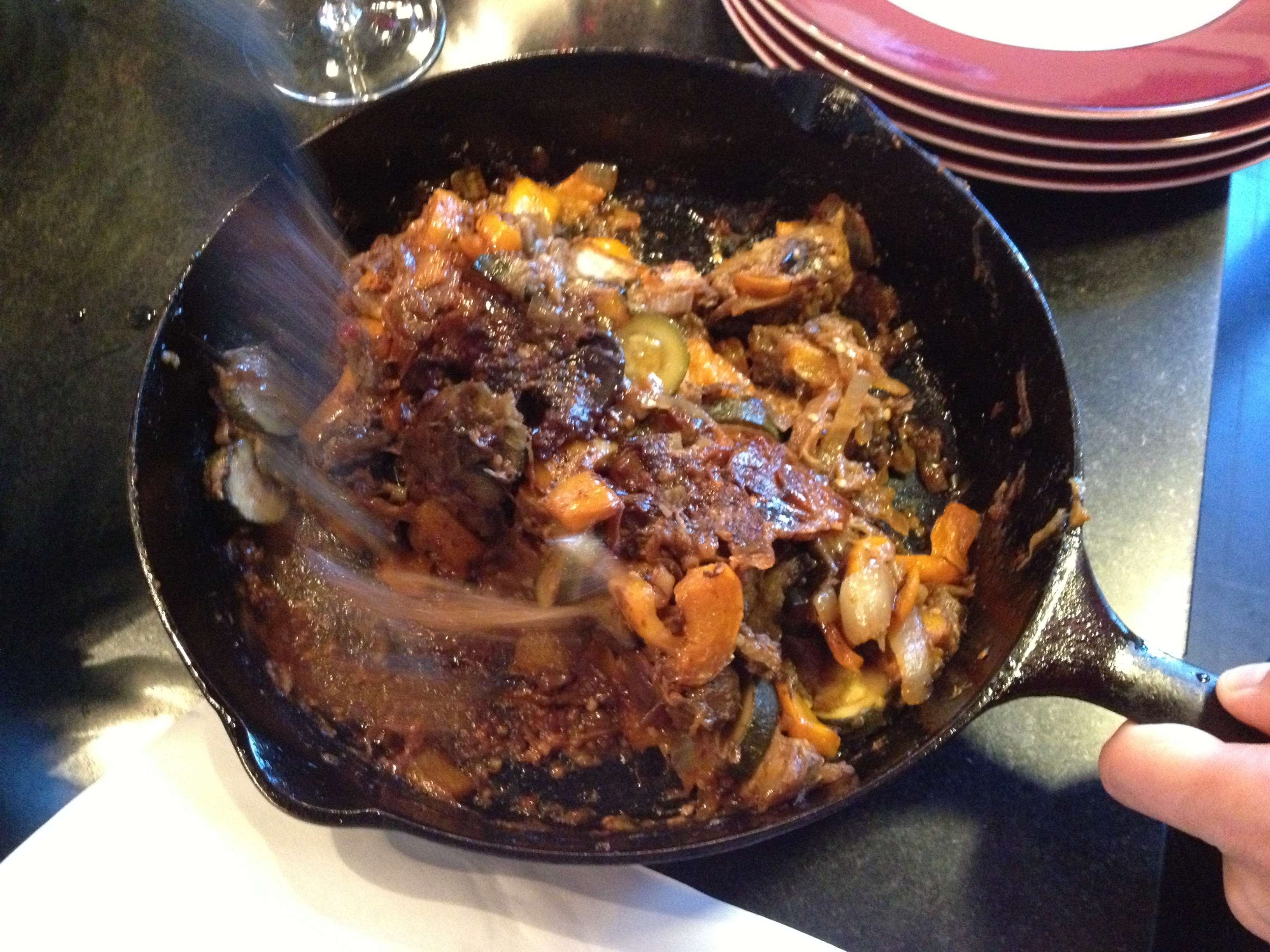 Skillet ratatouille being made in a black cast iron skillet, recipe from Food and Wine.