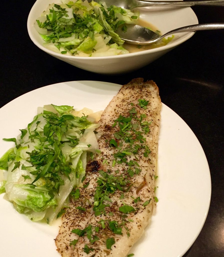 Gustus Vitae Taste of Provence Roasted Fillet of Sole garnished with cilantro on a white plate.