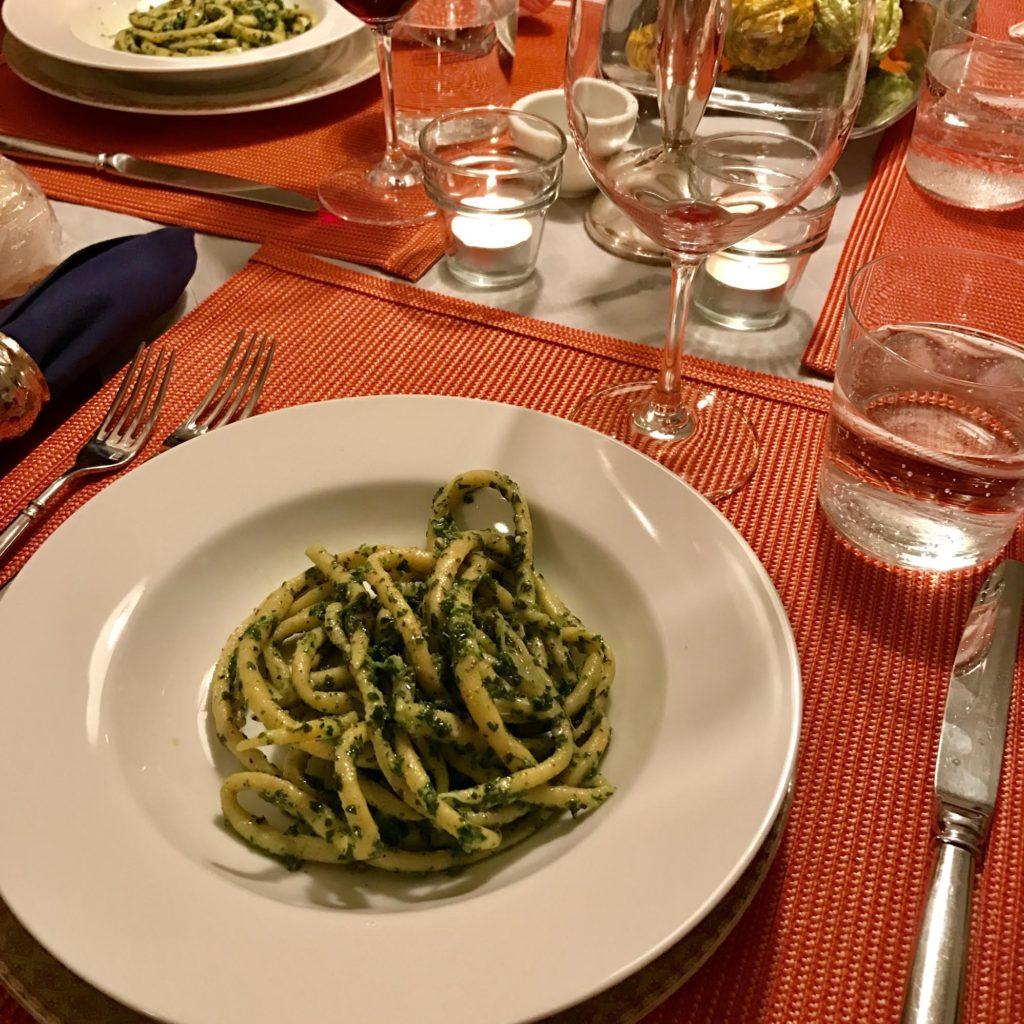 Pici pasta with a parsley, sage and Parmigiano pesto sauce.