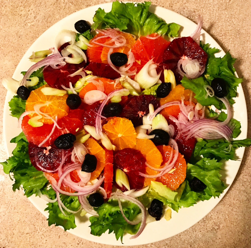 Refreshing Winter Citrus Salad Recipe on a round platter.