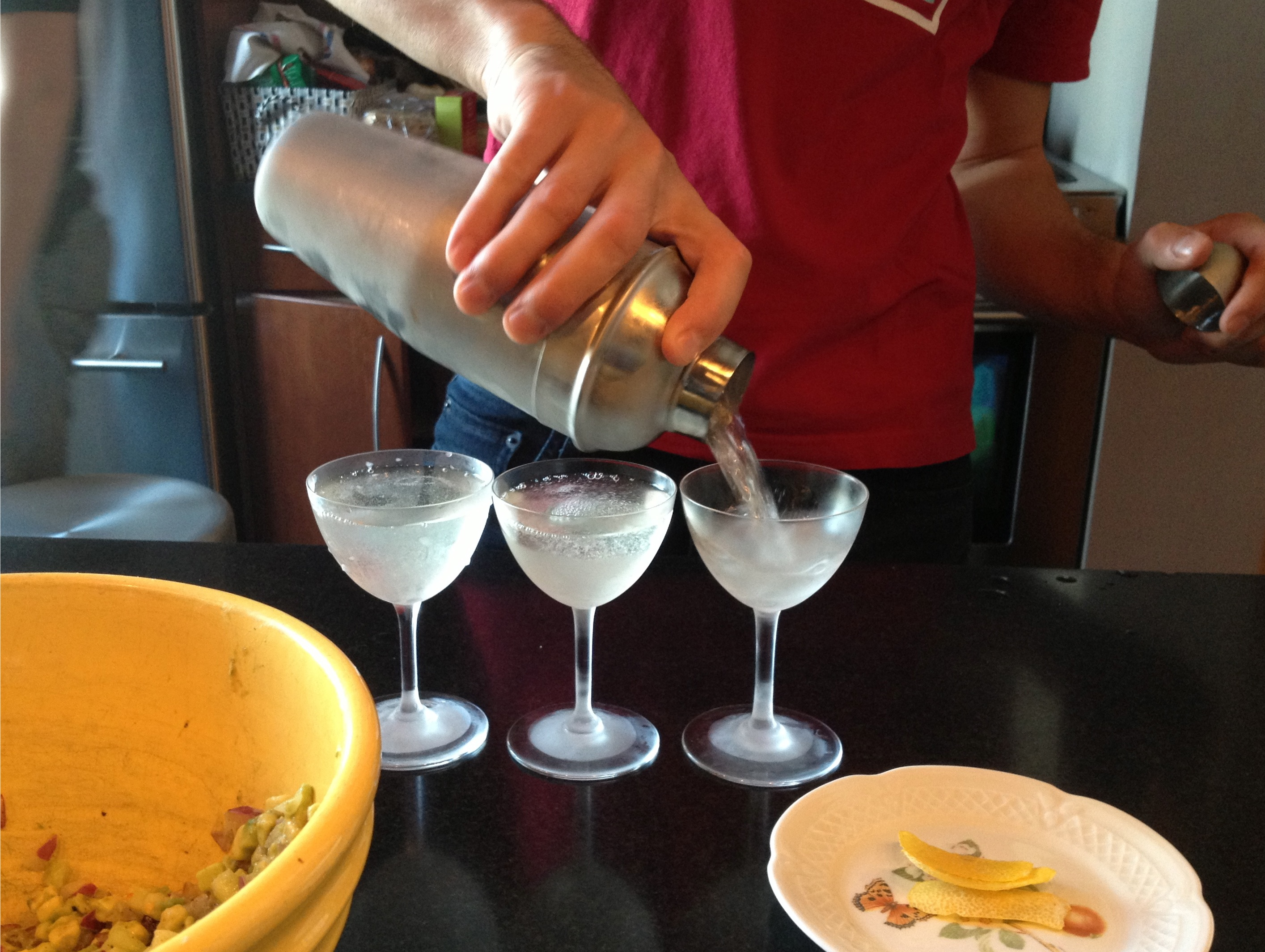 Vespers being poured into chilled Baccarat martini glasses for a Mother's Day dinner.